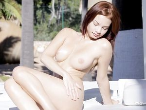 Perfect Body On A Redheaded Babe Playing Poolside