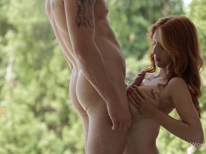 Red Haired Beauty On Her Knees Sucking Dick